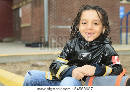 african child in the playground of a shool