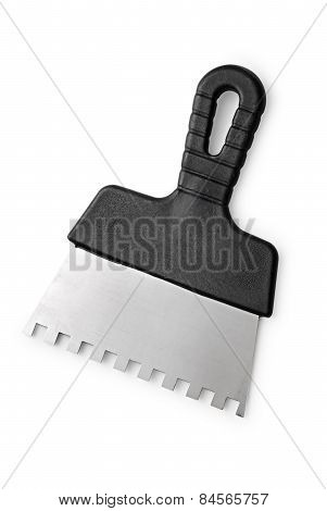 Notched Trowel With A Black Handle On A White Background