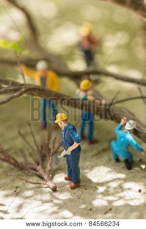 Miniature Workmen Clearing Fallen Trees