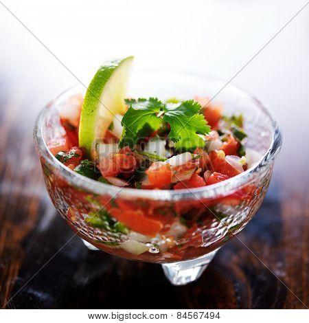 pico de gallo salsa in glass molcajete