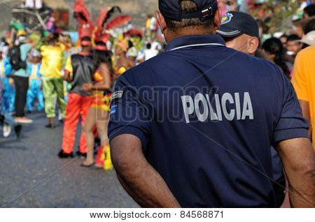 Police Officers Patrolling The Carnival