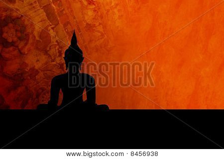 Black buddha silhouette, isolated against colorful background (incl. clipping path)