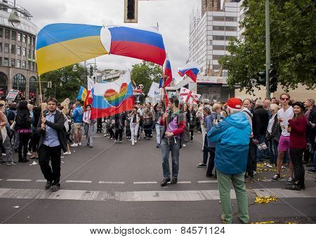 Participants With The Ukrainian And Russian Flag, During Gay Pride Parade