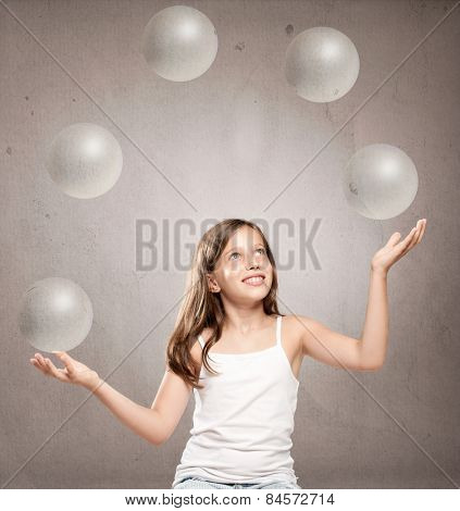 little girl juggling with crystal sphere balls