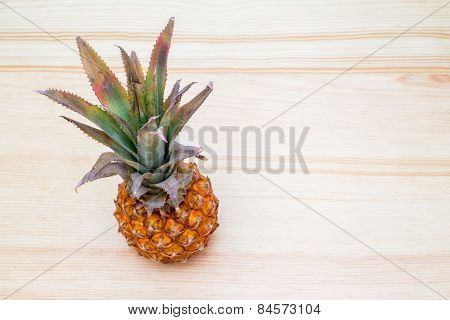 Fresh Pineapple On The Wooden Table