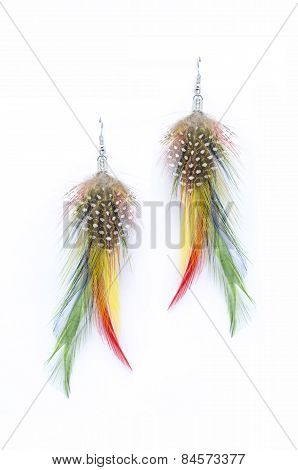 Earrings Made Of Feathers On A White Background