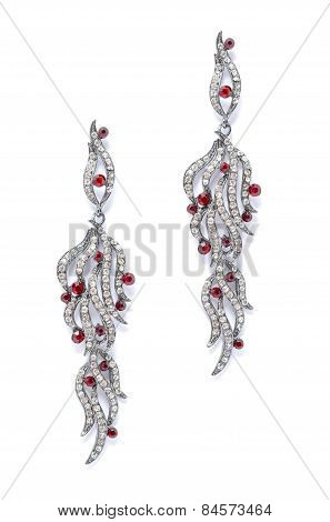 Silver Earrings With Red Stones On White Background