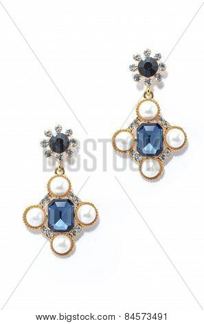 Earrings With Sapphire And Pearls Isolated On White Background