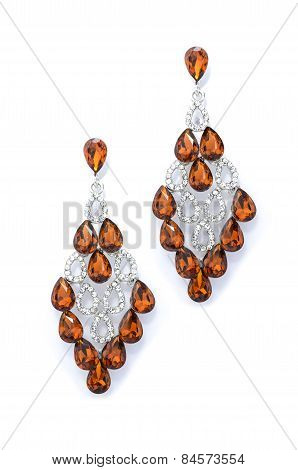 Amber Earrings On A White Background