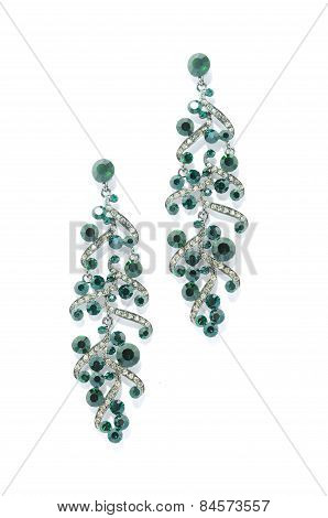 Earrings With Emerald   On A White Background
