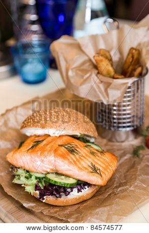 Restourant Serving Dish - Burger With Salmon, Frying Potato On Wooden Board