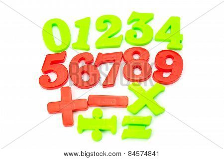 Colored Plastic Magnetic Numbers on White Background.