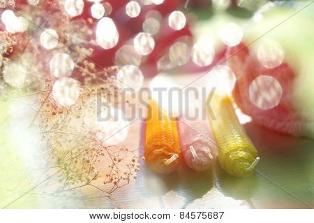 Natural beeswax candles on bright background