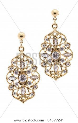 Gold Earrings Inlaid With Precious Stones On A White Background