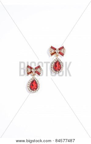 Ruby Earrings On A White Background