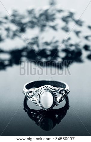 Vintage ring on reflective surface