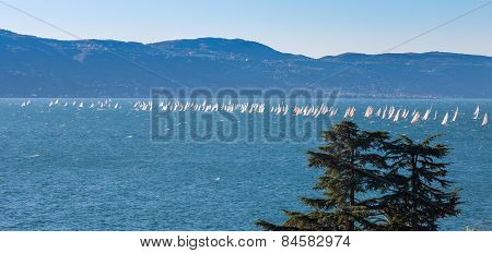 Sail Boat On A Lake With Mountains As Background