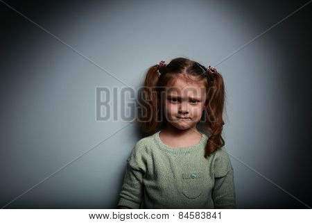 Sad Anger Kid Looking On Dark Background With Shadows