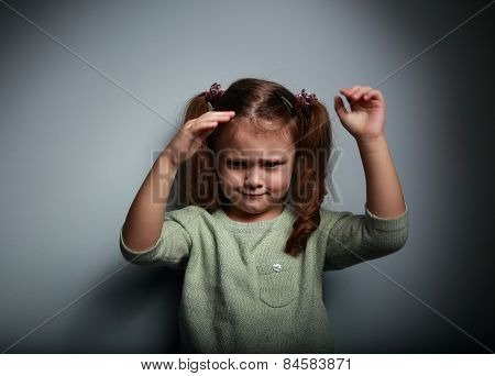 Angry Kid Girl Moving The Hands On Dark Background
