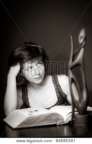 Young Woman Reading Big Book, Concentration And Attentiveness
