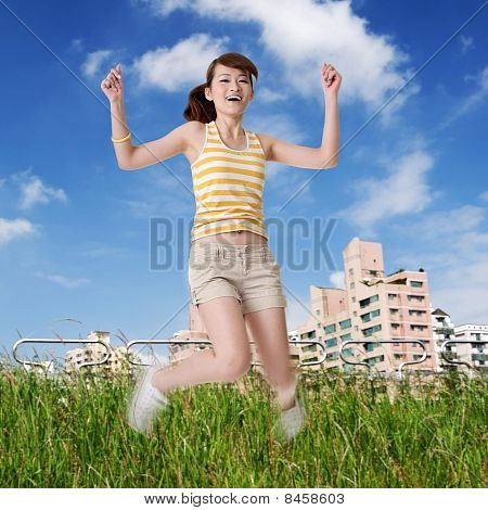 Happy Girl Jump In Park