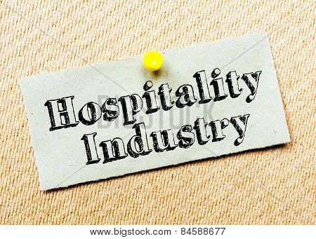 Recycled Paper Note Pinned On Cork Board. Hospitality Industry Message