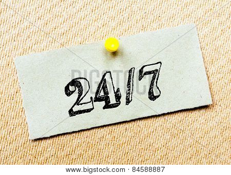 Recycled Paper Note Pinned On Cork Board. 24/7 Message