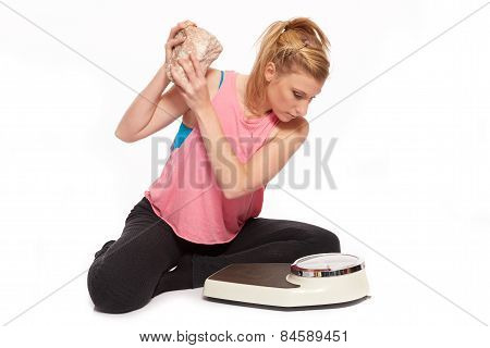 Young Woman Throwing A Stone At The Scale
