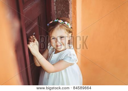Very cute little princess outdoors in city street