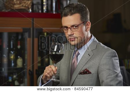 Wealthy Man Toasting With Wine