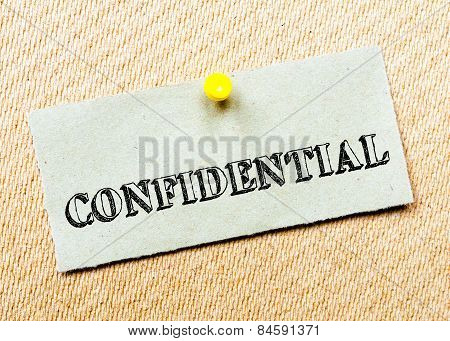 Recycled Paper Note Pinned On Cork Board.confidential Message