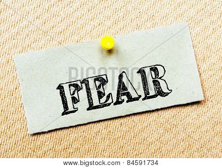 Recycled Paper Note Pinned On Cork Board. Fear Message