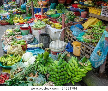 Fruits and vegetables for sale at an outdoor market