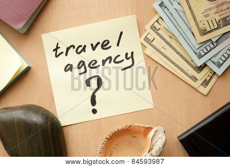 Travel agency paper on a table with money.