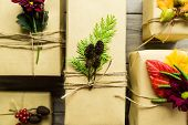 foto of embellish  - Gifts wrapped in kraft paper tied with twine and embellished with natural details - JPG