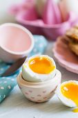 stock photo of duck egg blue  - Series on boiled duck egg for breakfast with toast soldiers  - JPG
