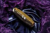 image of clutch  - golden clutch with diamonds on silk background - JPG