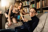 pic of men underwear  - Young man in glasses surprised in the library - JPG