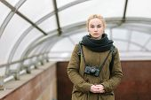 pic of dreadlocks  - Outdoors city portrait of young blonde hipster woman photographer with dreadlocks in scarf and military style olive parka - JPG