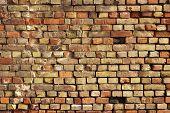 foto of shaky  - A striking wall of displaced and broken bricks - JPG