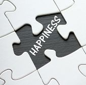 pic of missing  - The word Happiness on a blackboard revealed by a missing jigsaw puzzle piece - JPG