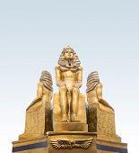 pic of pharaoh  - Golden ancient Egypt pharaohs statuette standing  on blue background - JPG