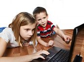 image of fanny  - Children looking to laptop lying on the floor - JPG