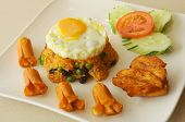 foto of fried chicken  - American Fried Rice is fried rice that put tomato suace and raisins and topped with fried egg served with fried chicken and sausages - JPG