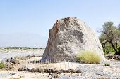stock photo of oman  - Image of the famous Colemans Rock in Oman - JPG