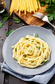pic of italian parsley  - Prepared tagliatelle with parsley on a plate - JPG