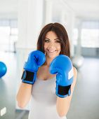 foto of boxing  - Young beautiful athlete brunette with long thick hair and green eyes - JPG
