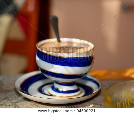 Coffee With Milk In Striped Bowl