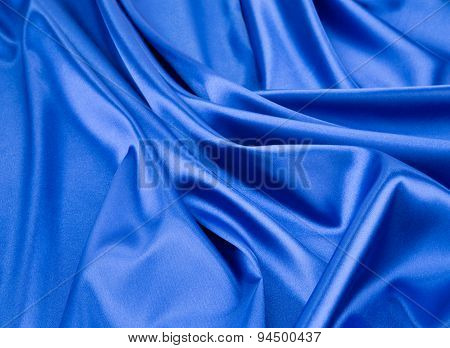 Close up of blue silk. Texture.