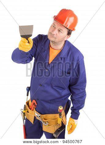 Worker in hard hat holding spatula.